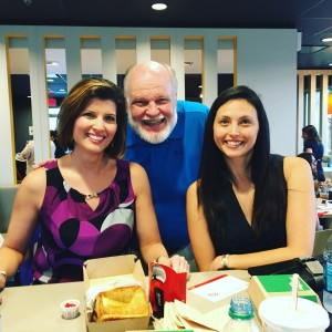 Tough duty being a food critic. This was snapped with KEYE weathercaster Chikage Windler and her sister at the introduction of the first McDonald's sandwich ever designed by a customer.